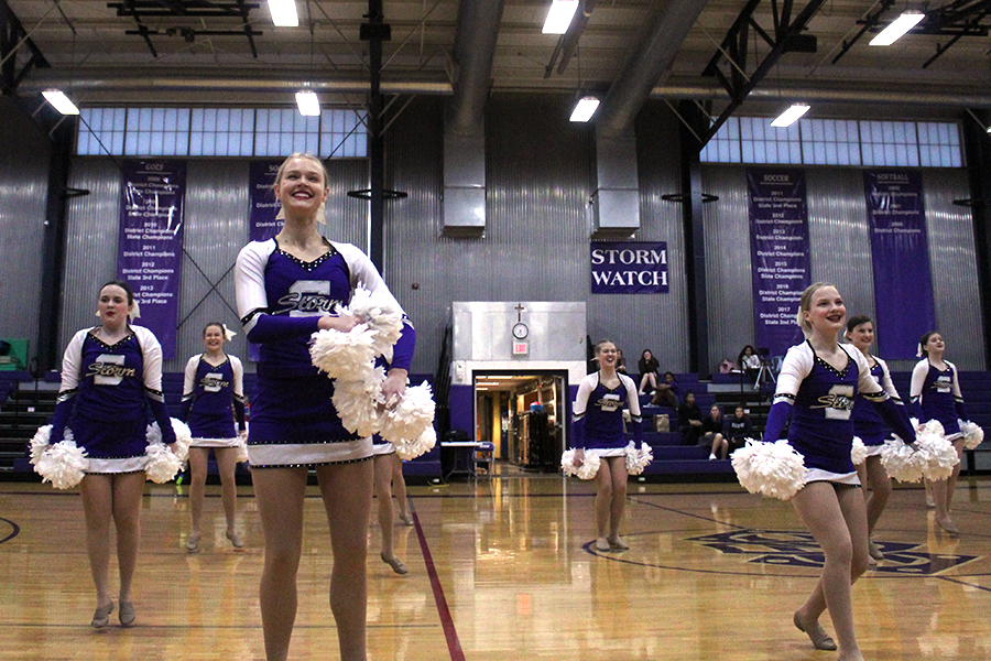 Dance team captain senior Libby Slaymaker leads the dance team in their halftime performance Feb. 12 at the varsity home game against Metro Academy. Storm won 47-13.