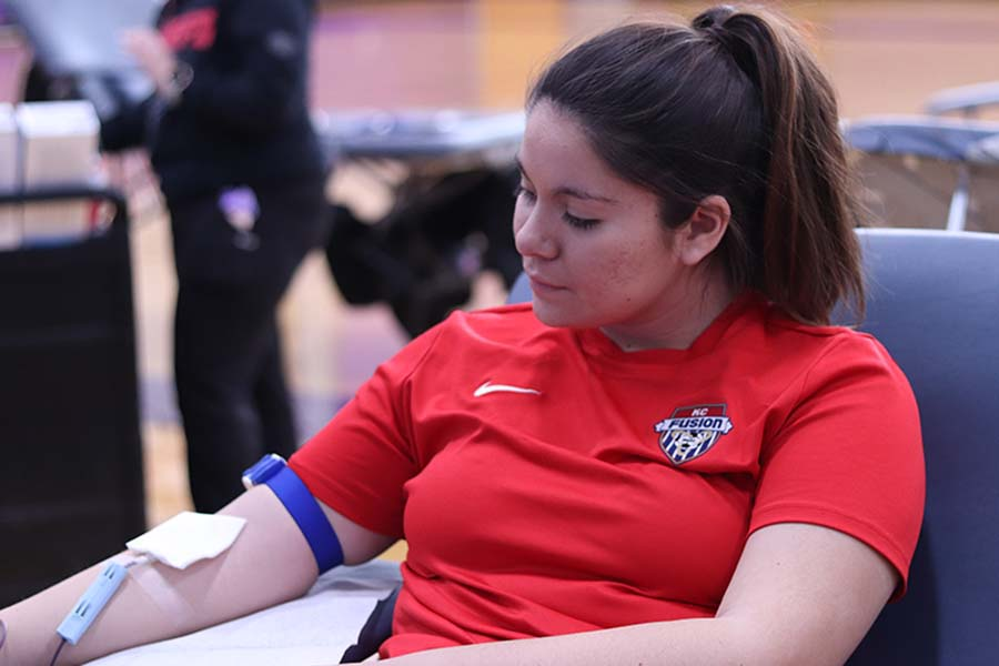 During the annual blood drive junior Genevieve Klobe donated Feb. 14 in the gym to Community Blood Center.