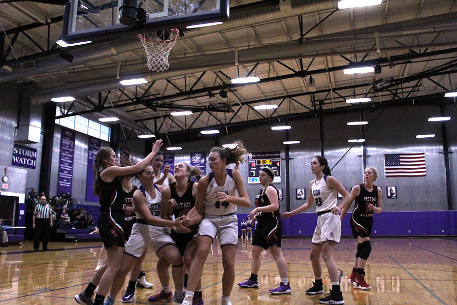 Players+fight+for+the+rebound+on+Storm%27s+offense+at+the+varsity+basketball+home+game+Feb.+12.+Varsity+beat+Metro+Academy+47-13.