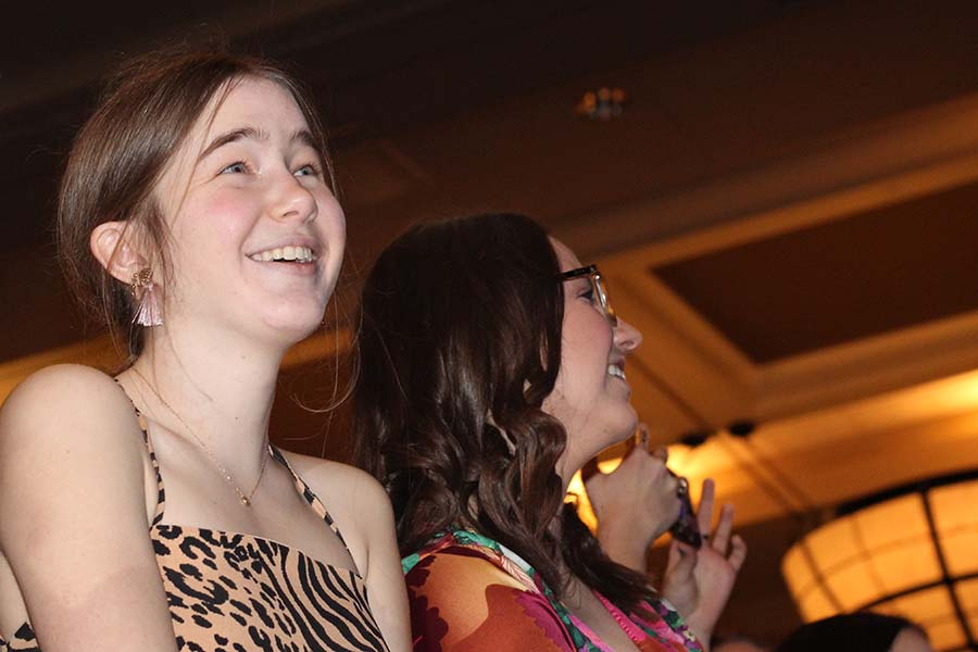 Senior Lilly Denney laughs at her father while he sings We Are the Champions by Queen during the annual Father-Daughter dance on Feb. 9. As tradition, fathers of seniors students serenade their daughter and senior students serenade their fathers.