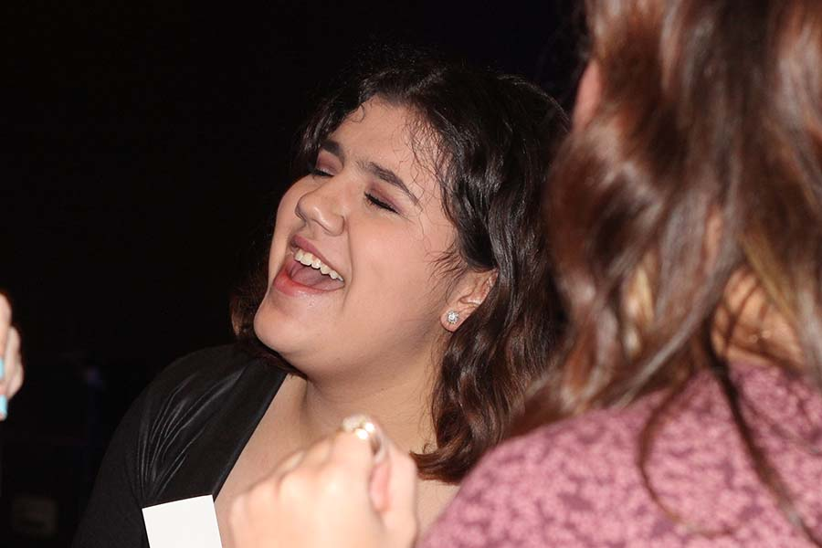 Senior Maya Bair sings along to a song during the annual Father Daughter dance on Feb. 9.