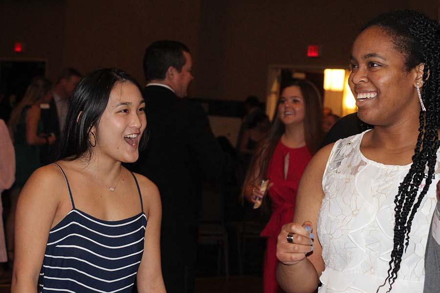 Seniors Caroline Ehren and Munachi Okuagu dance after dinner during the annual Father-Daughter dance Feb. 9.
