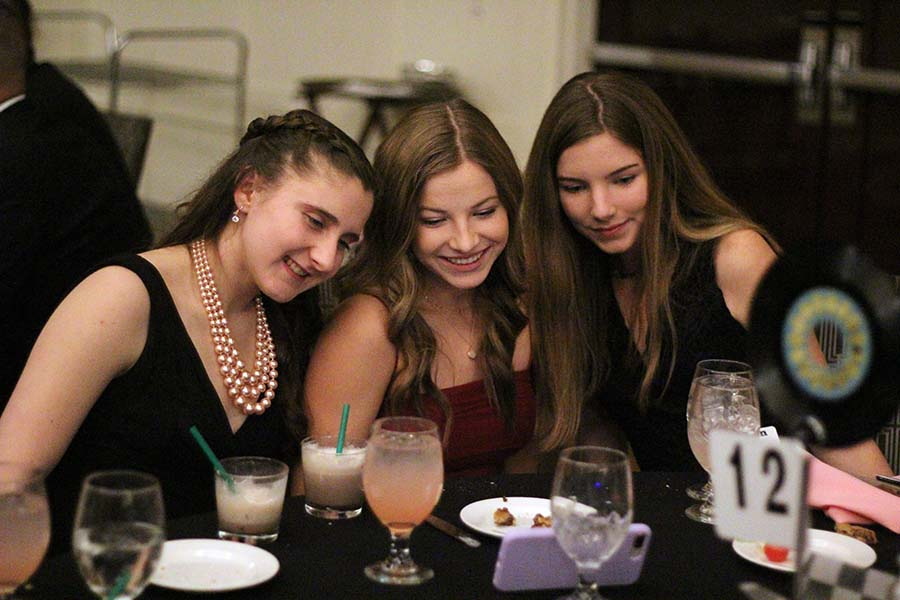 Sophomores Emily Joice, Kate McCarthy and Lauren Shaw pose for a selfie during the annual Father Daughter dance Feb. 9. Coinciding with this years Pink Ladies theme, burger sliders, mac and cheese and potato chips were served for dinner with chocolate chip cookies and a milkshake bar for dessert.