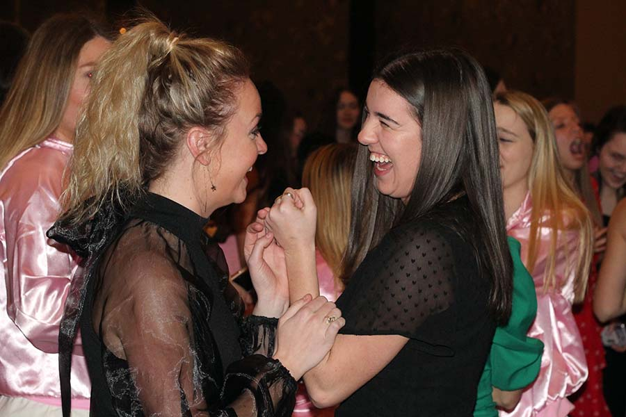 Seniors Sophia Angrisano and Maeve Hogg laugh while they dance during the annual Father-Daughter dance Saturday, Feb. 9.