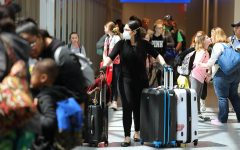 Some arriving travelers at the Orlando International Airport wear masks Thursday, March 12.