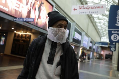 A passenger wears a face mask at a mostly empty Union Station railway station in Washington, D.C., due to the COVID-19 pandemic on Friday, March 20, 2020. (Photo by MCT Campus)