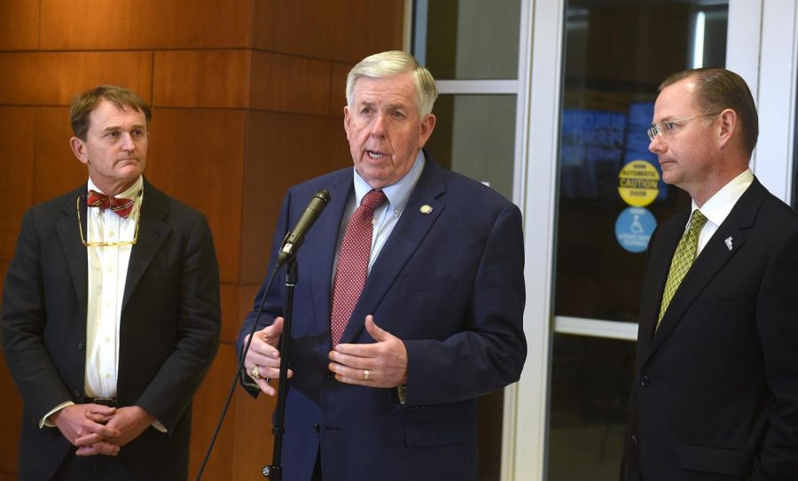Gov. Mike Parson, center, Missouri health director Randall Williams, left, and Mayor Brian Treece talk to the media during a press conference at City Hall in early March on the state's strategy for the coronavirus.