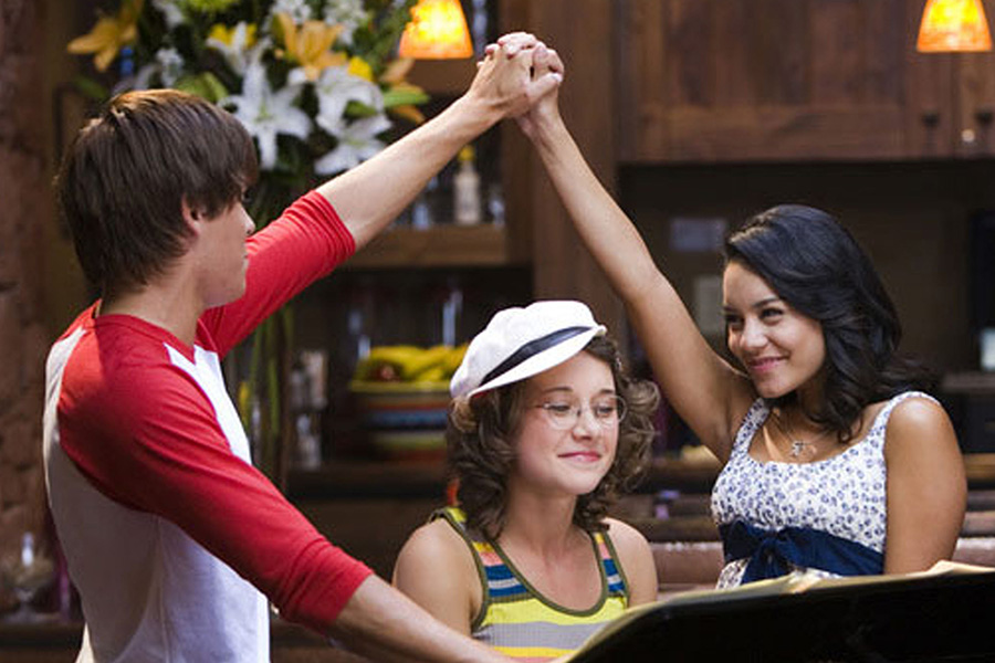 "From left, Zac Efron, Olesya Rulin and Vanessa Hudgens in ""High School Musical 2."" The ""Disney Family Singalong"" featured a ""Highschool Musical"" cast reunion. (Handout/TNS)"