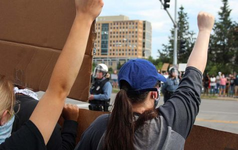 A protester holds up her fist in solidarity with the Black Lives Matter movement during the protest against police brutality at the Country Club Plaza on May 30.