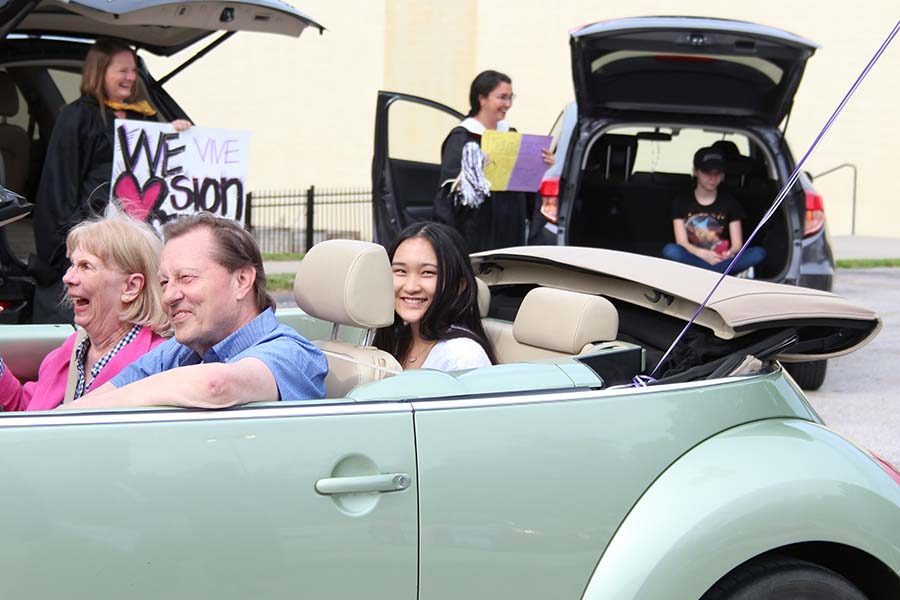 Senior Caroline Ehren drives through the graduation parade while being celebrated by her teachers in the parking lot on May 21.