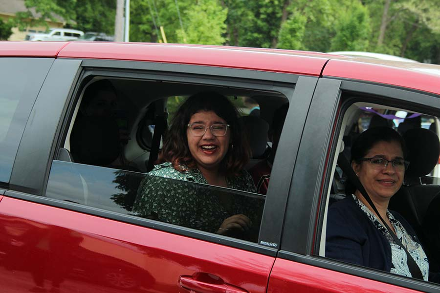 Senior Maya Bair cries as she drives past her teachers during the graduation parade in the parking lot on May 21. It was really exciting to see everyone, but I think I was the most excited to see Mrs. Mulkey, Bair said. She was and always is so pure.