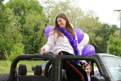 Senior Reilly Jackoboice greets her teachers from her car during the graduation parade that took place in the parking lot on May 21.