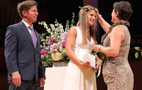Caroline Knopke '20 is crowned by her mother during the graduation ceremony at the Kauffman Center for the Performing Arts on Aug. 5.