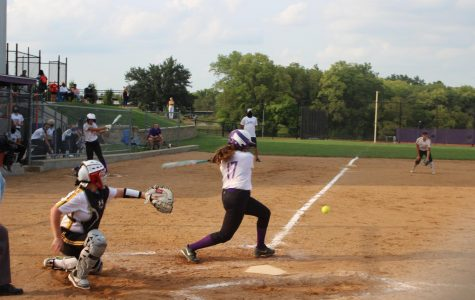 Junior Angelina Ferrara takes a swing at the rivals pitch Sept. 16.