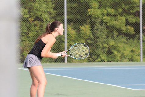 Senior Lindsey Dougherty waits in anticipation to receive a serve from Lexi Gunn during a tennis match against Blue Valley high school on Sept. 22