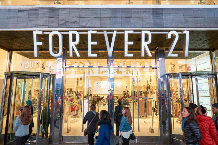 Shoppers stream into the Forever 21 location at Times Square, New York City.
