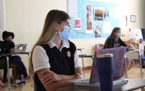 Senior Brynna Dow listens to Mrs. Shawn Watts explain the lesson plan during a
