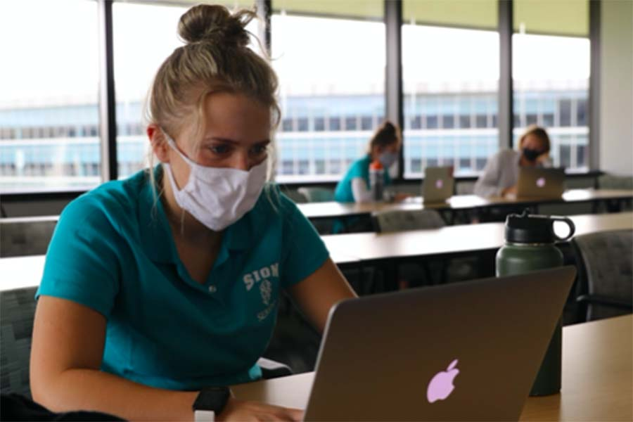 Senior Hannah McGraw works on her project for the Designing Real World Impacts Class at the Burns & McDonnell headquarters on Aug. 31.