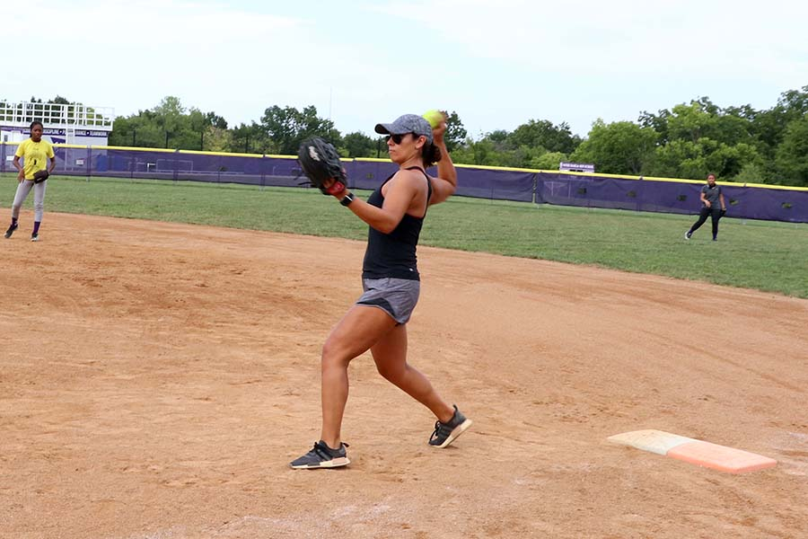 Softball coach Madi Osias demonstrated proper throwing technique to the softball team during practice on Sept. 8. Osias played professional softball as a pitcher with the Pennsylvania Rebellion.