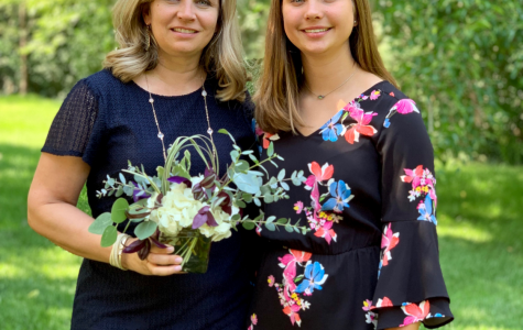 15-year-old Baklanov poses outside with her mother for a photo.
