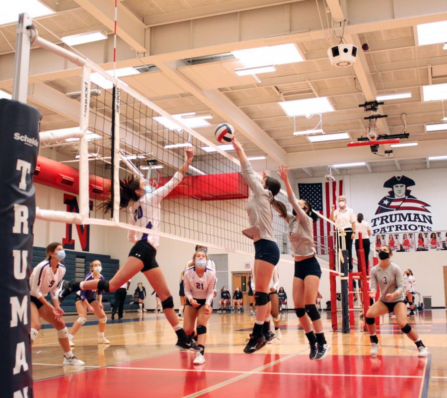 Junior+Anna+Sheedy+jumps+to+block+the+volleyball+as+a+student+from+William+Chrisman+High+School+sets+it+over+the+net.+