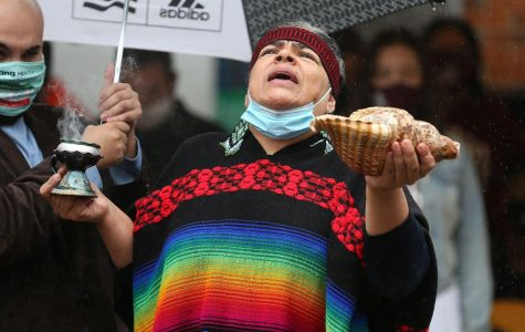 Susana Angelica Ollin Kuikatl Banuelos recites a prayer at a celebration for Indigenous Peoples Day in Chicago on Oct. 12, 2020.