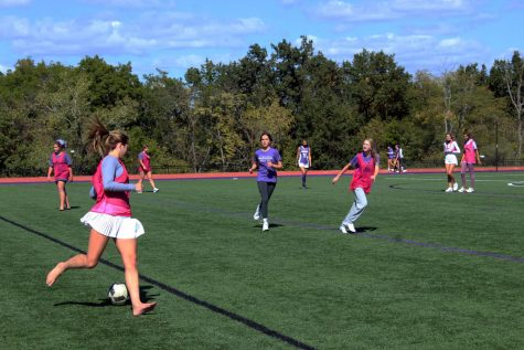 Students play a half-field soccer scrimmage on the turf during Field Day on Oct. 1.