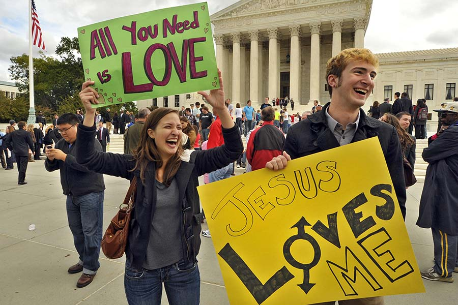 Students from St. Mary's College, including Allison Yancone, left, offered a counter-message to the signs displayed by members of the Westboro Baptist Church group outside the U.S. Supreme Court in Washington, D.C., Wednesday, October 6, 2010. Supreme Court justices pondered the vexing question of whether the father of a dead Marine from Westminster, Maryland, should win his lawsuit against the fundamentalist church group that picketed his son's funeral. (Amy Davis/Baltimore Sun/MCT)