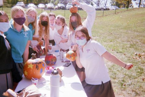 Seniors decorate pumpkins a few weeks after the senior retreat.