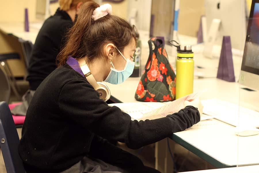 Junior Elizabeth Nordhus studies for her finals in the journalism lab on Dec. 7.