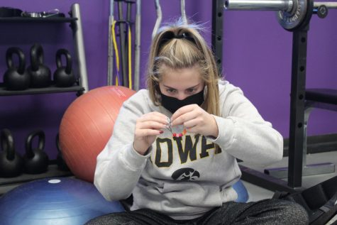 Senior Averi Myrick makes a bracelet with her maison while reflecting on the Interfaith Prayer Service Jan. 21.