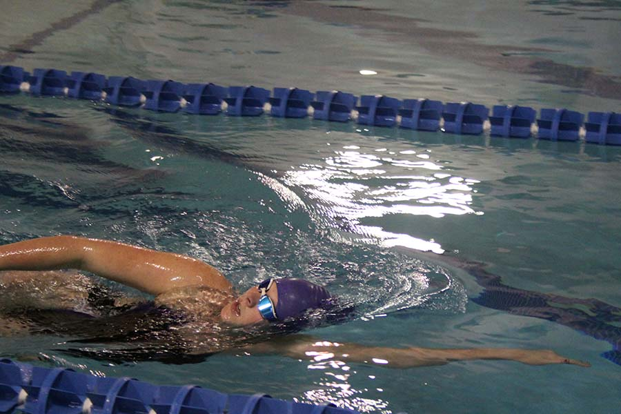 Senior Kate Vankeirsbilck competes in a race during the swim and dive meet against St. Teresa's Academy at the Red Bridge YMCA on Jan. 26.