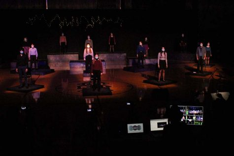 The entire musical cast performs the opening song while the tech crew manages the live streaming.