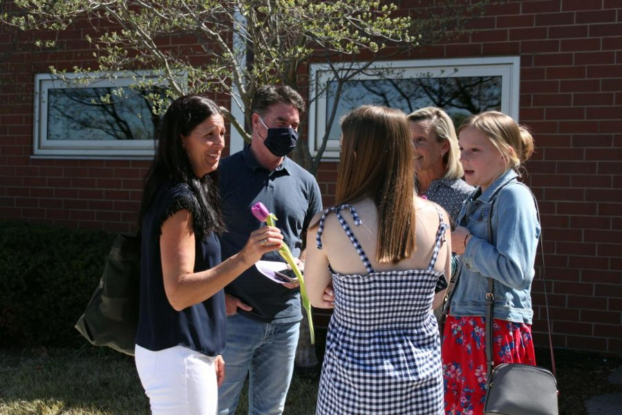 Class of 19' alumna Molly Conway converses with her family after presenting her sister with her junior ring.