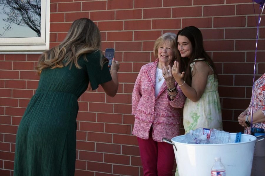 Senior Anna McQueeny snaps pictures of senior Grace Hills and her grandmother, who is also an alumna, featuring their junior rings.