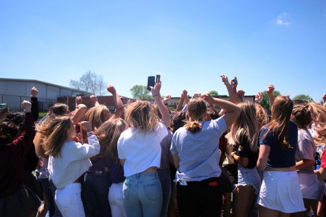 "All the 2021 seniors jump chanting ""seniors rock the house"" one last time in the courtyard on May 6.."