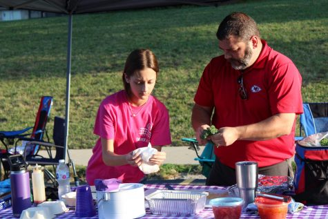 Freshman Addi Bowes and father Bob Bowes get ready to compete in cook-off at the father daughter BBQ.