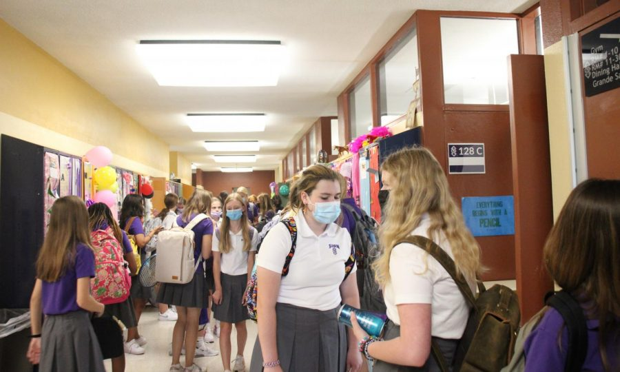 The freshman hallway was teeming with students going from class to class. Noting what she likes about being a freshman as Sion, freshman Gretchen Kowalewich said,