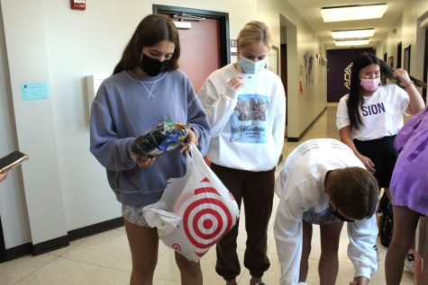 Juniors Brynna Fitzgerald, Claire Coats, Anna Golian, and Annie Stevens add together the totals of Fridays Socks for juniors.
